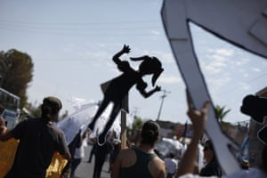 FTA: Tomas Bravo: Residents hold up cardboard figures during a march in Chihuahua