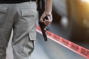 FTA: Tomas Bravo: A police detective stands guard at a crime scene in Monterrey