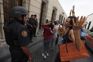FTA: Tomas Bravo: A woman argues with a policeman during a candlelight vigil
