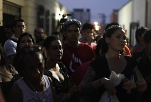 FTA: Tomas Bravo: People take part in a peaceful demonstration outside the Cafe Iguana bar