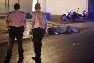 FTA: Tomas Bravo: Transit policemen look at the bodies of their colleagues in Monterrey