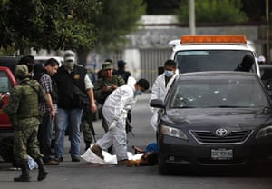 FTA: Tomas Bravo: Members of a forensic team prepare to remove the slain body