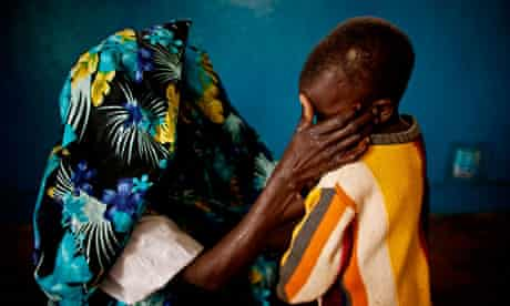 A mass rape victim and her son in the town of Fizi, Democratic Republic of Congo (DRC)