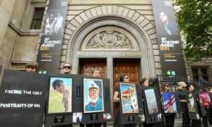 Climate activists protest outside the official opening of the BP Portrait Award