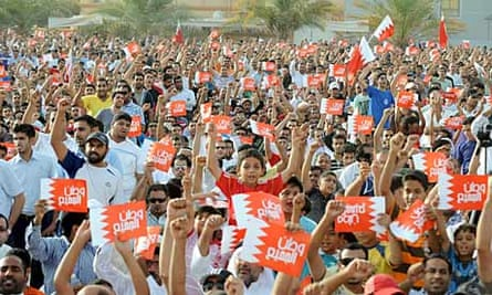 Bahraini pro-reform protesters raise signs calling for 'a country for all'