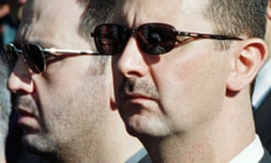 Syrian president Bashar al-Assad (r) and his younger brother Maher