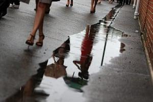 Ascot Ladies Day: Racegoers arrive at Ascot as the rain falls