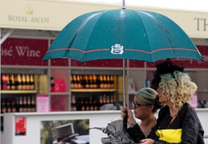 Ascot Ladies day: Racegoers arrive to a rainy Ladies Day at the annual Royal Ascot meeting