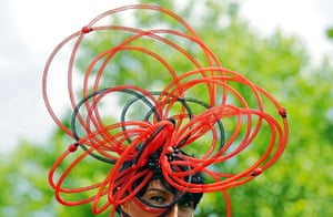 Ascot Ladies Day: A Race-goer wearing flamboyant hats