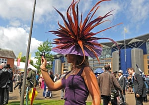 Ascot Ladies Day: A race-goer wearing a flamboyant hat takes a picture