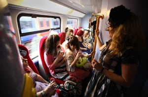Ascot Ladies Day: Race goers ride a train to Ascot