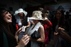 Ascot Ladies Day: Race goers laugh as they arrive by train at Ascot