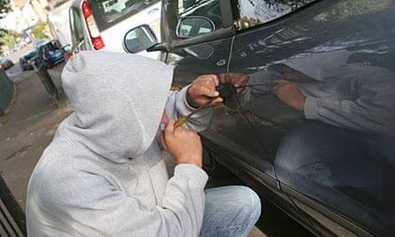 Car thief attempts break in.