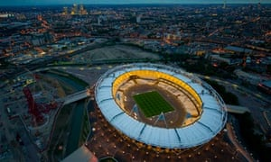 The 2012 Olympic stadium illuminated for the first time