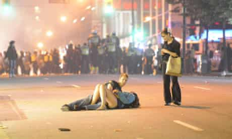 A second photograph taken by Richard Lam of the 'kissing couple' lying in a Vancouver street