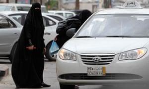 Saudi women board a taxi in Riyadh