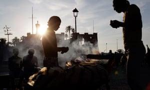A street vendor sells kebabs in central Tripoli, Libya