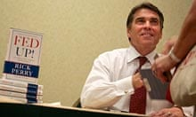 Rick Perry signs copies of his book for supporters