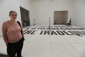 Venice Biennale: Dora Garcia poses front her artwork 'Lo Inadecuado' in Spain Pavillion