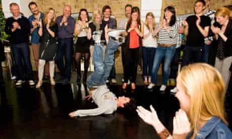 Patrick Kingsley tries breakdancing at branding agency The Partners.