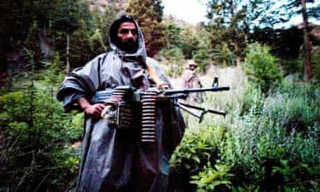Haqqani Taliban fighters in their mountain camp in eastern Afghanistan
