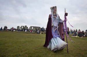 Summer solstice: A reveller at Stonehenge as people gather to celebrate the pagan festival