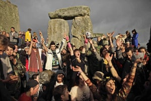 Summer solstice: Revellers cheer as the sun finally breaks through