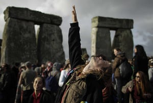 Summer solstice: A reveller reaches up to the sky during the summer solstice