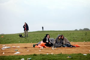 Summer solstice: Revellers sit in a litter strewn area