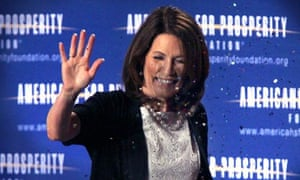 Republican presidential hopeful Michele Bachmann is showered with glitter, 18 June 2011.