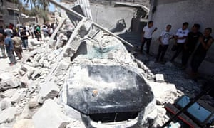 Rubble from a house and car in Tripoli claimed to have been hit by Nato bombs