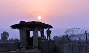 US soldier stands on a guard tower in Khost province, eastern Afghanistan