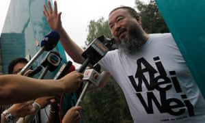 Chinese artist Ai Weiwei opens the gate to talk to journalists gathered outside his home in Beijing