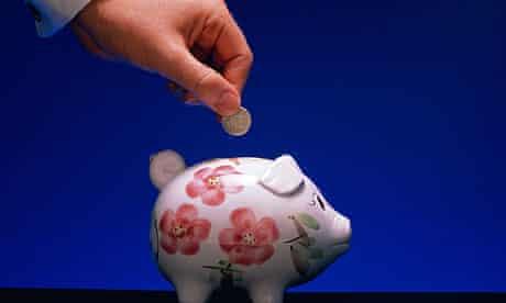 man filling piggy bank