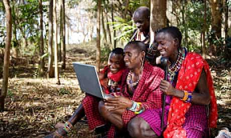 Men in Traditional African Dress Using a Laptop