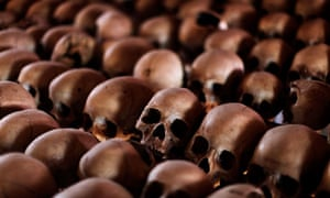 The skulls of Rwandan victims rest on shelves at a genocide memorial