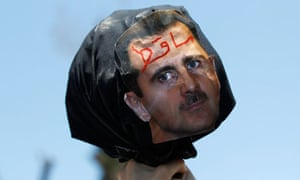 A Syrian demonstrator holds up effigy of President Assad