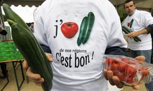 A French vegetable farmer wears a T-shirt reading 'I love tomato and cucumber from our regions'