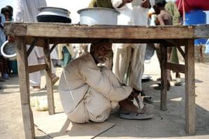 2010 extreme weather: An Internally displaced Pakistani man ta