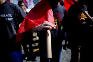 Greece strikes : A marcher carries a red flag on his way to the parliament building