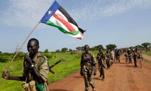 Sudan People's Liberation Army soldier carries the army flag