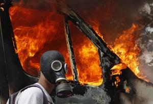 Greece strikes : burning outside broadcast van in Syntagma Square