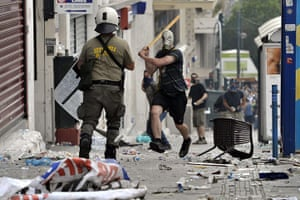 Greece strikes : A protestor charges at police