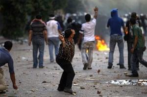 Cairo Clashes: Demonstrators throw stones in Cairo