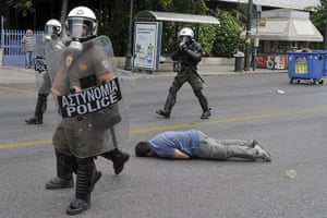 Greek strike day 2: A demonstrator after being struck by police