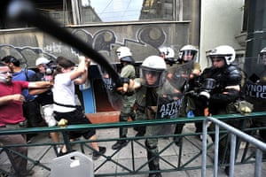 Greek strike day 2: A policeman hits out at a photographer