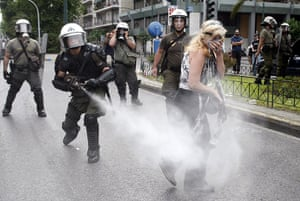 Greek strike day 2: A policeman sprays tear gas