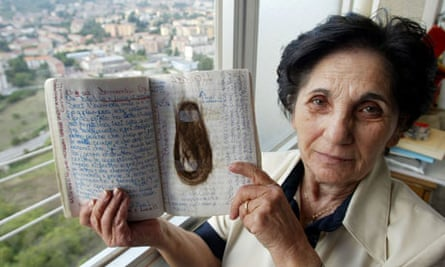 Elisa Claps's mother with her daughter's diary and a lock of her hair.