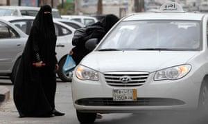 Saudi women hail a taxi in Riyadh