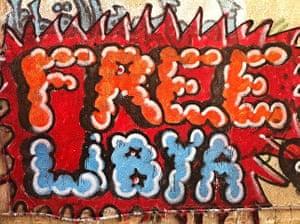 Gaddafi street art: Free Libya